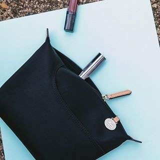 Inspired by our much loved Pocket Bag, this lightweight and spacious pouch is perfect for taking away on your travels!
