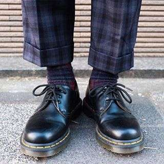 DOC'S & SOCKS: The 1461 shoe is a classic style, as are a good pair of check socks. Shop now through the link in our bio.
