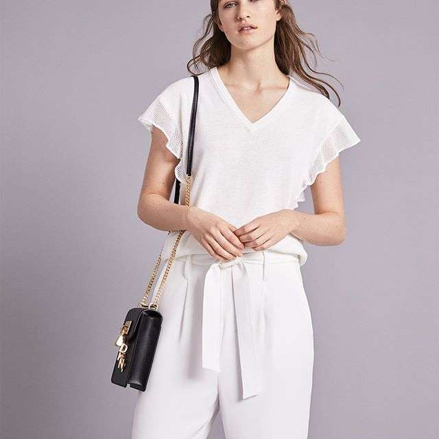 Lighten up.Keep it fresh in white: shop now on DKNY.com. #DKNYSpring2018