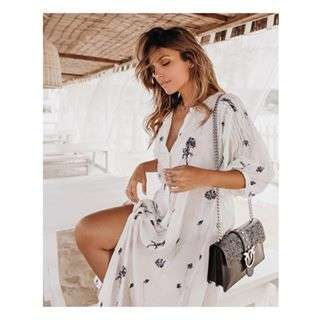 What the perfect moment looks like: @mafaldacastro lounging in #PINKO long kaftan and #PINKOLove bag with laser-cut macramé details. #SS18 #PINKOStars
