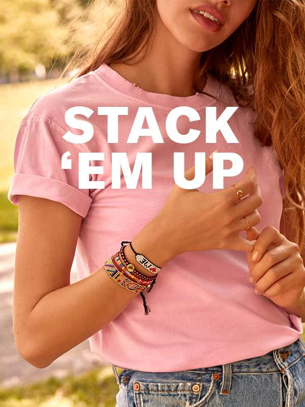 The accessories look of the moment: piles (and piles) of bold, bright bracelets.